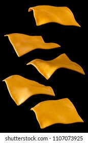 Peaces of yellow cheese flying on a black background