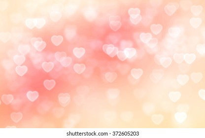 Peach color heart-shaped bokeh background