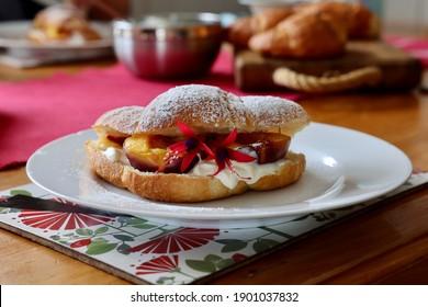 Peach in Croissant dessert with cream