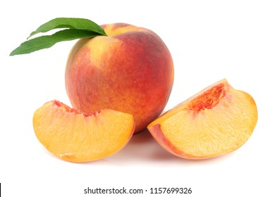 peach fruit with green leaf and slices isolated on white background