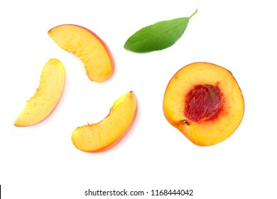 peach fruit with green leaf and slices isolated on white background. top view