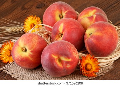 peach fruits still life decoration on old wooden board
