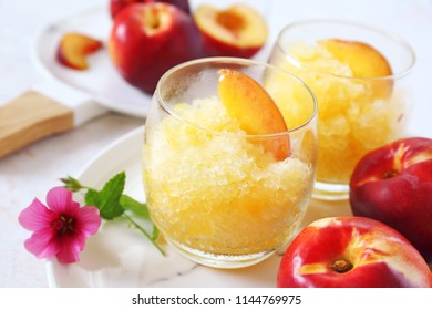 Peach granita and red fruits, frozen summer dessert, selective focus, two cups