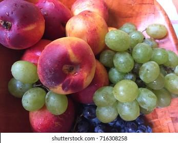 Peach and grape fruit close up macro photography.
