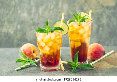 Peach ice tea with ice, lime and mint in the glass