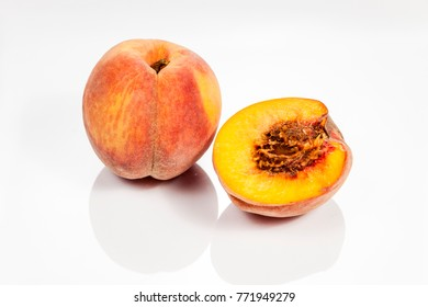 Peach isolated on white reflective background