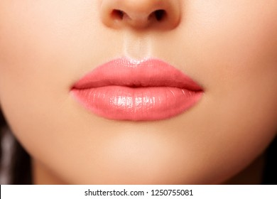 Peach Lip Gloss. beautiful natural lips nude. Sexy Lips. Beautiful Make-up Closeup. Lip Gloss Peach Color. Texture. Volume and Beauty of the Lips. plump  lips