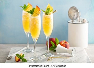 Peach mimosa or bellini cocktails for brunch
