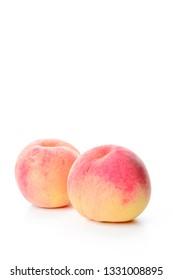 Peach on white background.