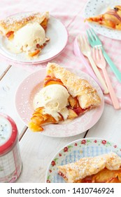 Peach pie with a scoop of vanilla ice cream
