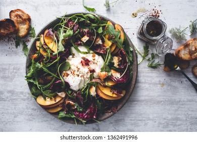 Peach Salad with Burrata, Arugula, Lettuce and Bread. Summer healthy Salad