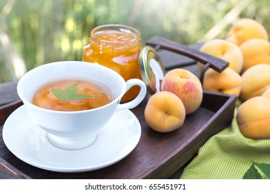 Peach tea and peach fruits with fruit jam, selective focus