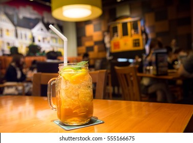 Peach tea with lemon in a glass ready to served at the restaurant.
