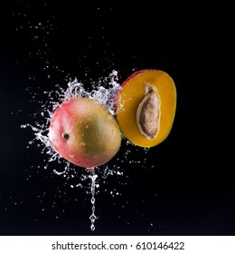 Peach with water splash isolated on black background