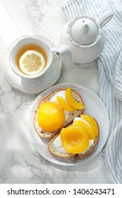 Peach and yogurt on french bread for healthy breakfast image