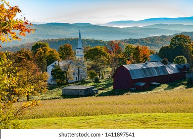 Peacham Congregational Church and a farm with red barn.  The church is the Olde Meeting House in the Village, Peacham, VT