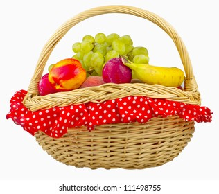 Peaches, banana, grape and other fruits in an old style basket isolated over white