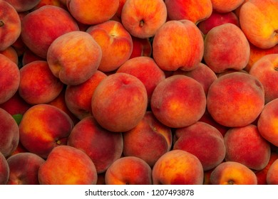Peaches - broken ripe fruits. Background with ripe peaches.