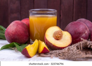 Peaches with a glass of a fresh peach juice