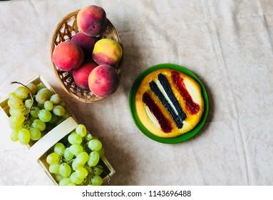 Peaches, grapes and homemade cake