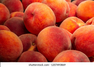 Peaches - ripe fruit. Background with peaches. Broken fruits.