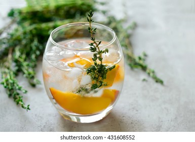 Peaches and thyme cocktail or lemonade or infused water