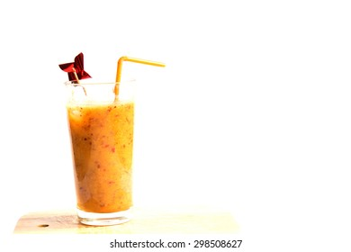 Peachy Drink With Windmill Stick And Straw On Board On White Background