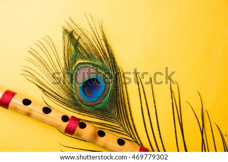 peacock feather bamboo flute over colourful stock photo edit now