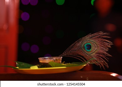 Peacock feather, known as Mayilpeeli in Malayalam, is dipped in a bowl of henna paste which is used to dye Indian brides' palm before wedding