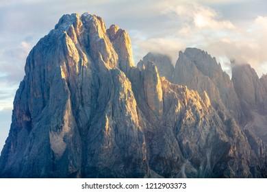 Peak in the Alps lit in sunlight