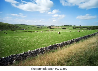 peak district landscape with fields and dry stone walls