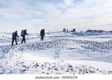 PEAK DISTRICT, UK - CIRCA 2012: Group of hikers climb Kinder Scout in winter. Peak District, UK.