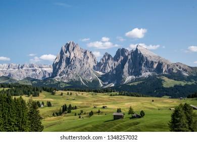 Peak, fields and mountain lodge. Typical mountain landscape during summer season. Seiser Alm Alpe di Siusi landscape, Sudtirol Alps