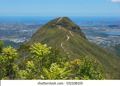 The peak Malaoui with the Pacific ocean and the city of Noumea in background, New Caledonia, south Pacific
