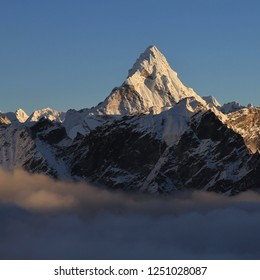 Peak of Mount Ama Dablam just before sunset, view from Kala Patthar. Nepal.