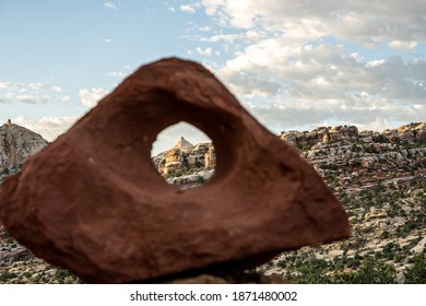 Peak of Mountain in Focus Through Blurry Sandstone Rock in Capitol Reef National Park along the Fryingpan Trail