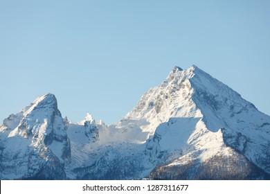 Peak of Mountain Watzmann an sunrise in winter with fog in valley, Berchtesgaden Bavaria