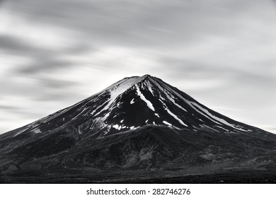 The peak of Mt.Fuji in black and white scene, smooth flow of clouds which is effects by ND500 filter to made a slow speed shutter in a day time shot.