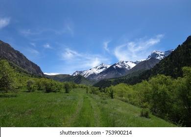 Peak Sayram, is highest peak of the Ugam Range. View from the valley of the Sayram-Su River. Sayram-Ugam state national natural park, The Ugam Range, Western Tien-Shan. South Kazakhstan. 10 June 2017.