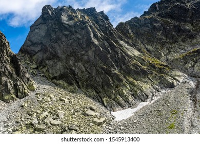 Peak - Wschodni Szczyt Zelaznych Wrot (Vychodny Zelezny stit) - one of the numerous peaks lying on the line of the Main Ridge of the Tatra Mountains - view in summer and autumn conditions. - Shutterstock ID 1545913400