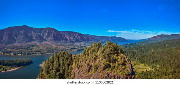 Peaking over the top of Beacon Rock on a sunny summer morning in the Columbia River Gorge