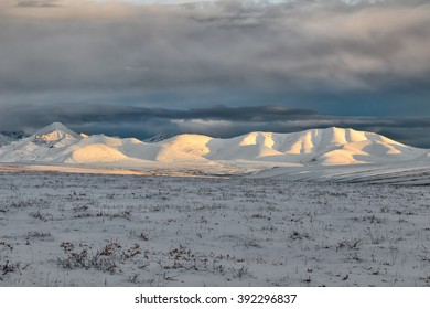 The peaks of the Brooks Range rise above the tundra of Alaska's North Slope