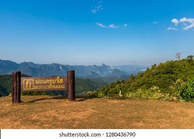 "Peaks in the faint fog viewed from Mon (Peak) Kruba Sai scenic viewpoint and campsite in Mae Moei National Park at Tha Song Yang District, Tak Province, Thailand. (Thai words mean ""Mon Kruba Sai"")"