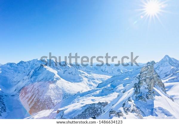Peaks of Hintertux Glacier ski resort in Tyrol in Mayrhofen in Zillertal valley in Austria in winter Alps. Nature in Hintertuxer Gletscher in Alpine mountains with white snow. Sun shining.