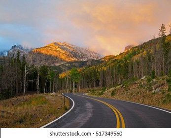 The peaks light up at sunrise along Bear Lake Road in Rocky Mountain National Park.