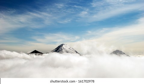 peaks of mountains above the clouds, Russia, Kamchatka