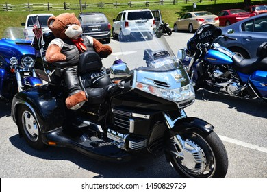 Peaks of Otter, Virginia / USA - July 13, 2019: A biker teddy bear attached to a motorcycle in the parking lot of the Peaks of Otter lodge along the Blue Ridge Parkway.