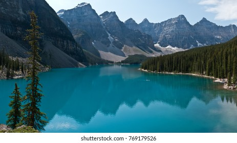 Peaks reflected in the still waters of Moraine Lake, Jasper National Park, Alberta, Canada