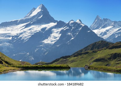 Peaks of the Schreckhorn and Finsteraarhorn from the Bachalpsee lake in the Swiss Alps.