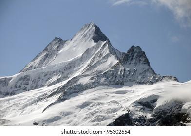 Peaks of Schreckhorn in fresh summer snow
